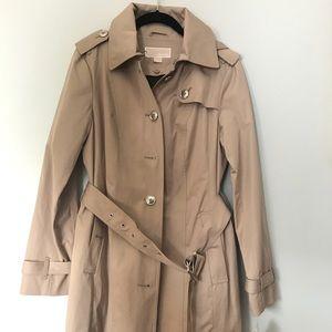 Woman's small beige jacket